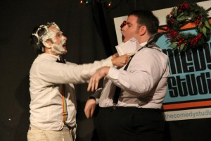 Sean Sullivan and Nate Johnson perform together at The Comedy Studio Holiday Show.