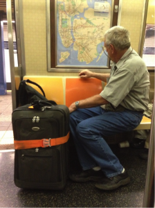 If this man is trying to figure out the NYC subway system, he's going to have to sit and think for a while.